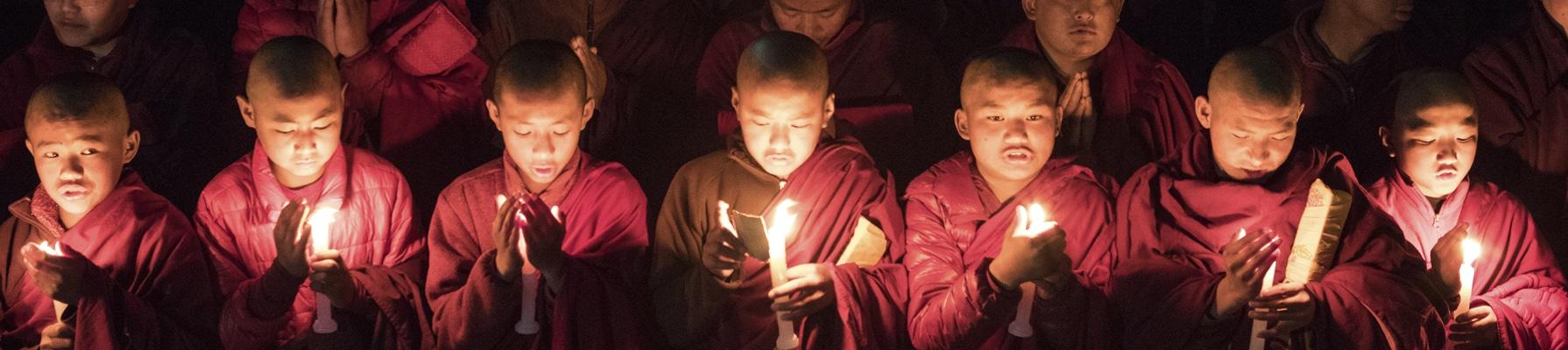novice monks at prayer in Bhutan