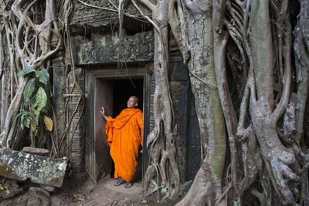 Monk at the Angkor watts being used as an example of including people in images