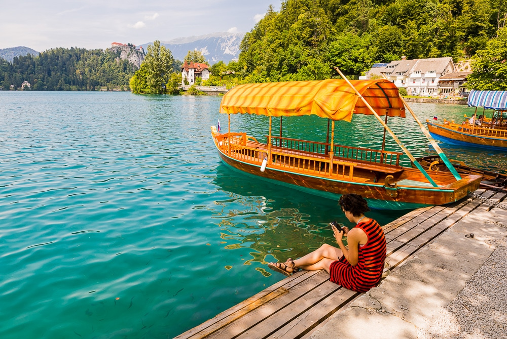 Woman-sitting-beside-lake-bled