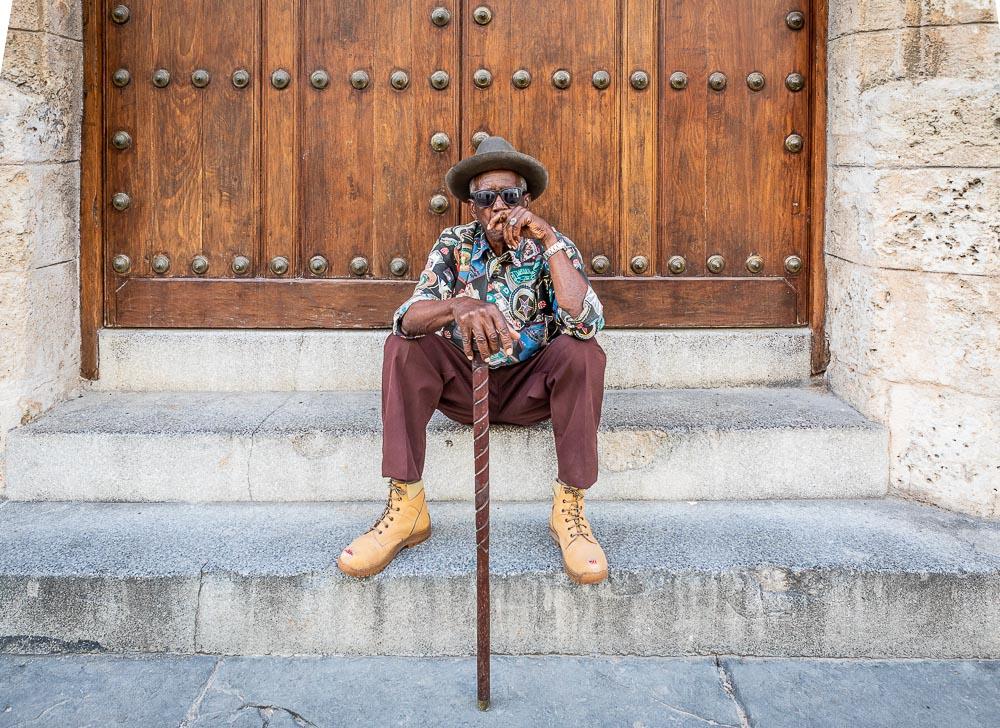portrait of man smoking cigar in havana
