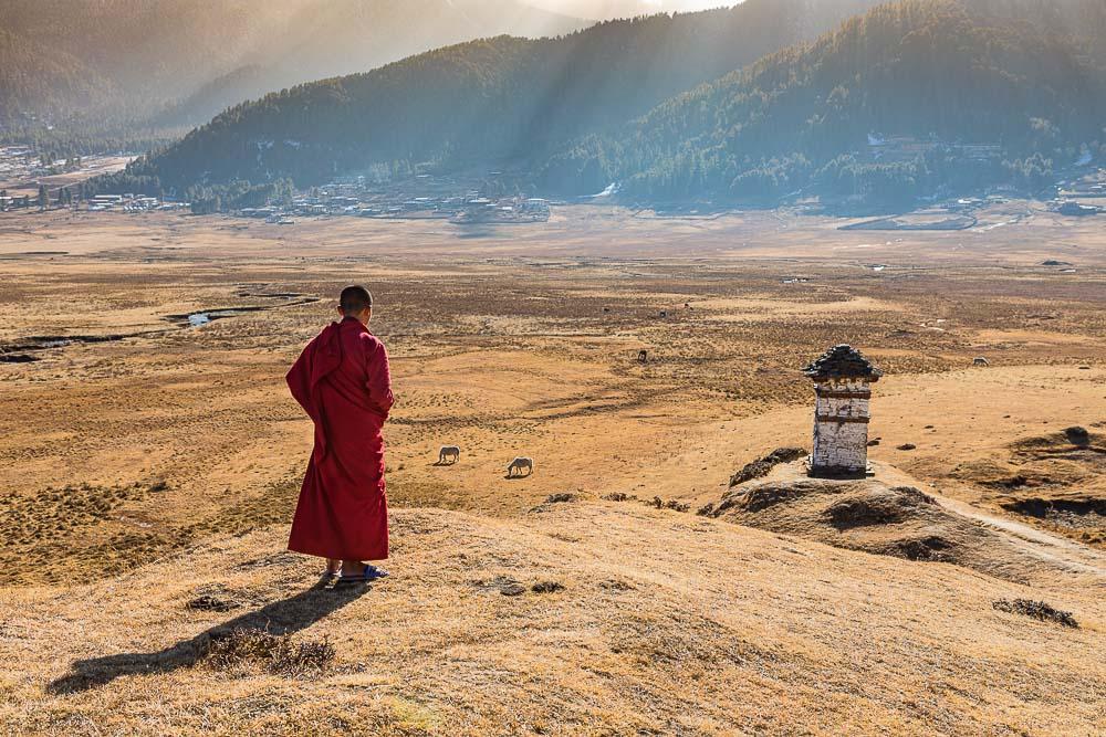 Novice Monks (Child Monks) looking at stupa in Phobjikha Valley, Bhutan