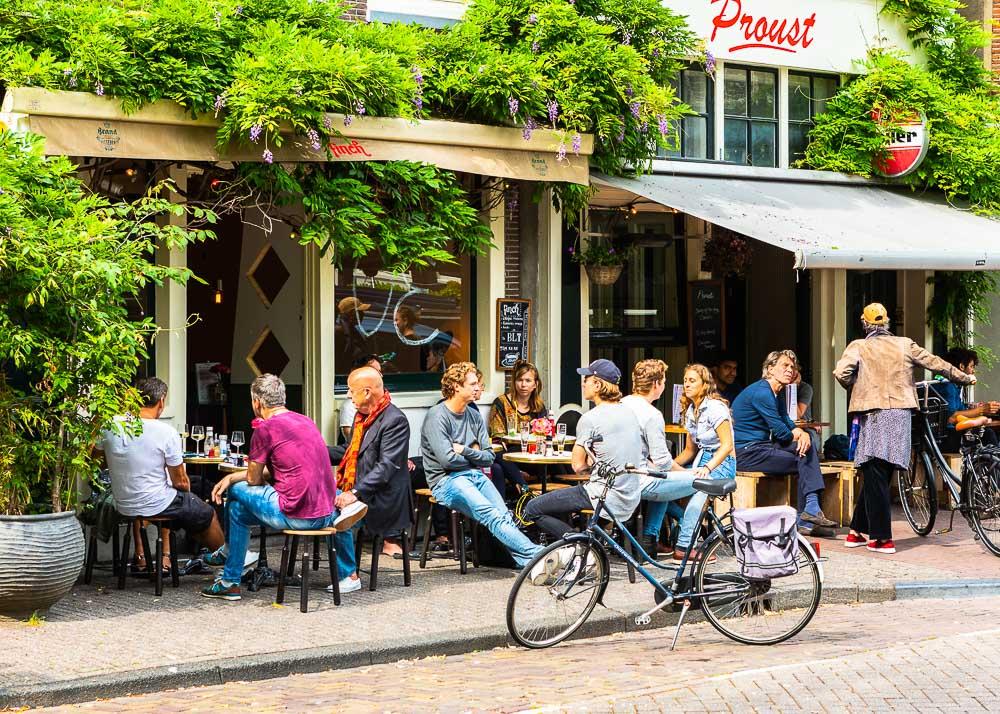 People sitting outside a bar in Jordaan area, Amsterdam, Netherlands